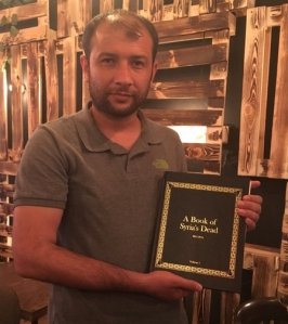 "SCD Leader Raed Al-Saleh recieves ""A Book of Syria's Dead"""
