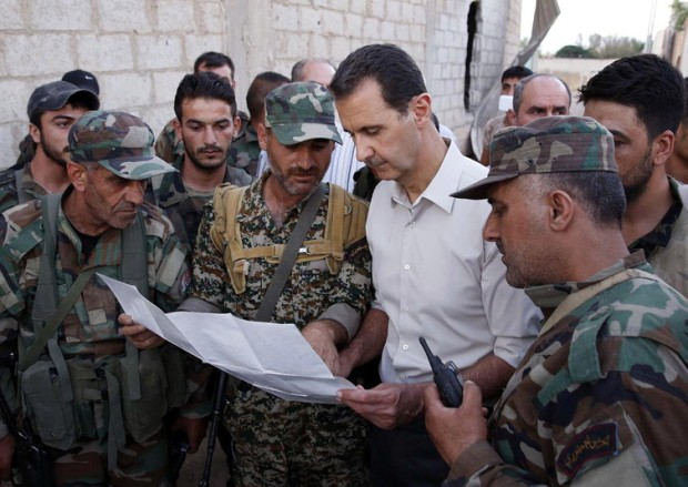 Bashar al-Assad visits his soldiers. SANA/EPA
